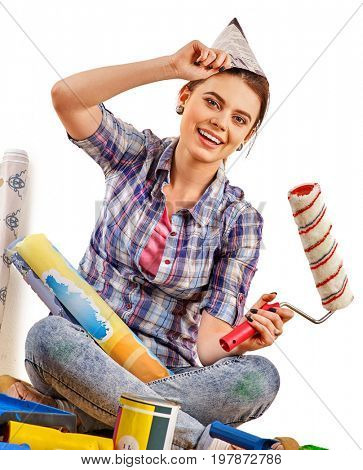 Repair home woman holding paint roller for wallpaper. Aggressive screaming girl in newspaper cap renovation apartment on isolated. Girl is glad to choose right materials. Student at work.