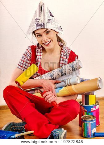 Repair home woman holding paint roller for wallpaper. Aggressive screaming girl in newspaper cap renovation apartment on isolated. Girl is glad to choose right materials. She took a loan for repairs.