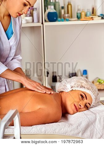 Massage room for therapy deals. Woman therapist making manual therapy back. Hands of masseuse treatment of spinal injuries 40 old mature client in spa salon. Woman enjoys relaxing at a spa salon.