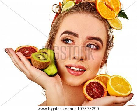Hair mask from fresh fruits on woman head. Girl with beautiful face hold ingredient for homemade organic skin and hair therapy. Concept of healthy and beauty hair and skin. Means for skin rejuvenation