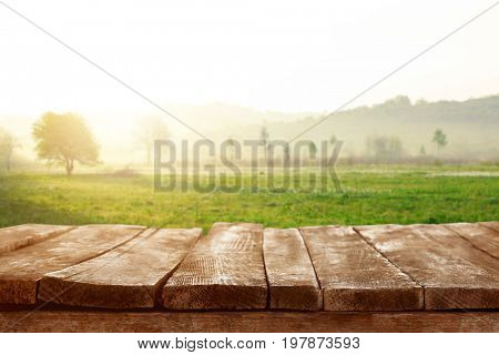 Empty wooden table and beautiful landscape on background