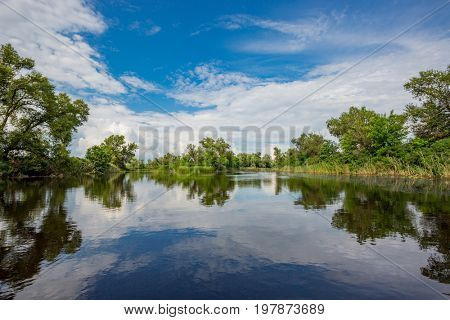 summer day with nice sky over river