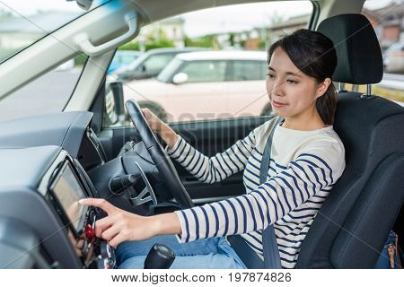 Woman driving car and using GPS system