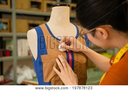 Female Clothing Design Tailor Working In Dummy