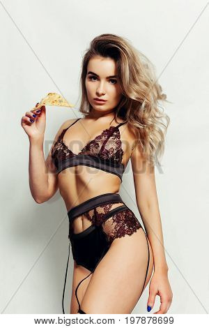 Young Sexy Woman In Black Underweartasty Slice Of Pizza