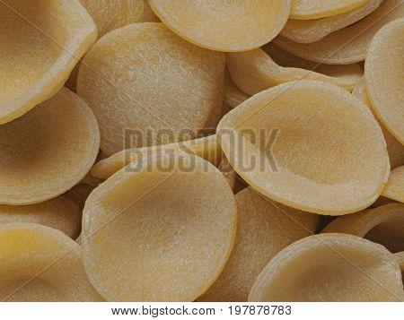 close up of dried italian orecchiette pasta food background