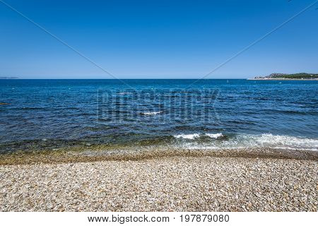 Rocky beach of Costa Brava in beautiful town of l'Escala, Spain.