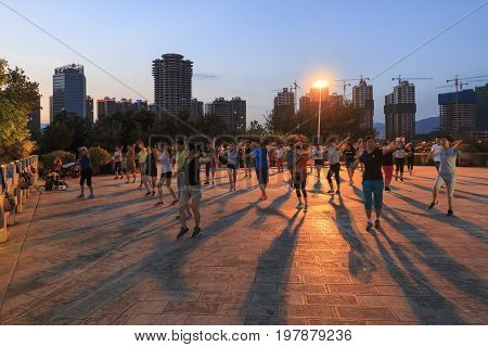 Yuxi, China - July 29, 2017: Chinese People Dancing In Nie Er Music Square Park, One Of The Biggest