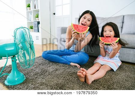 Beautiful Mother With Daughter Eating Watermelon