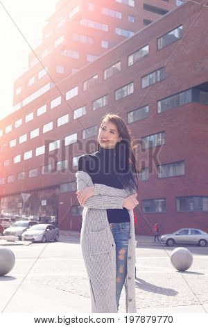 Young Fashion Brunette Business Woman Against Business Center At Sunset
