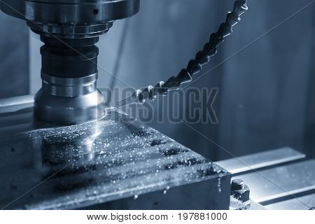 The CNC milling machine cutting the raw material with the index-able tool in light blue scene.The rough cutter for CNC machine with lighting effect