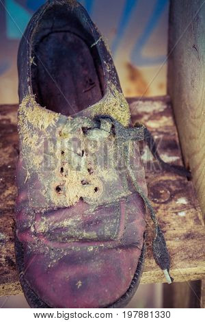 Some very old  worn out shoes in close up