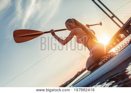 Woman On Sup Board