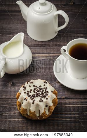 cake in glaze cup of coffee creamer and teapot