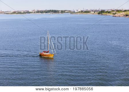Wooden yacht or sail boat on calm blue sea