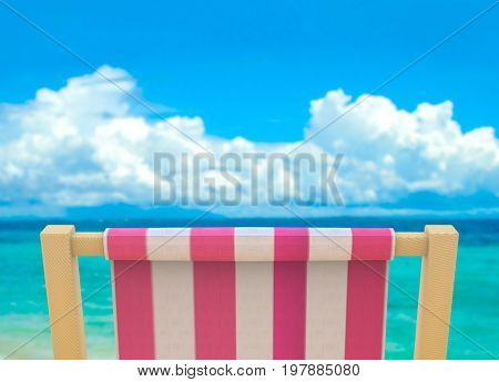 beach chiar with blurred sea and blue sky as background.
