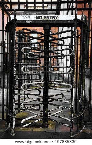 Old rusty No Entry turnstile in a street in Derry Northern Ireland