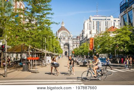 ANTWERP, BELGIUM. July 19, 2017. Cyclists at the central De Keyserlei street with the Antwerp central station in the background.