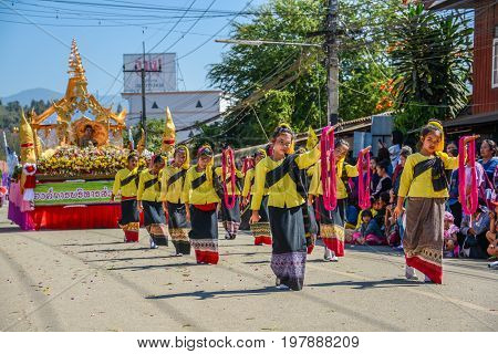 CHIANGMAI THAILAND - JANUARY 25 2015: Indigenous little girls with traditional costume dancing in traditional style in parade of 22nd Traditional Skirt Fabric and The Indigenous Product and Culture Festival in Mae Chaem Chiangmai Thailand