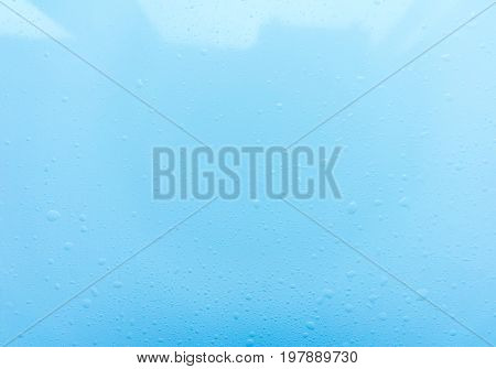 Drops, water splashes on blue background. Cute simple background, backdrop. Top view. Close-up. Stock photo.