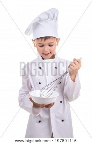Diligent small cooker mixing ingredients in a special cooking dish. Recipe