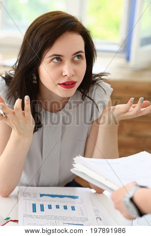 Woman business annoyed at confusion confusion pulling her hands from a lot of paper work does not understand how you can bring as many documents