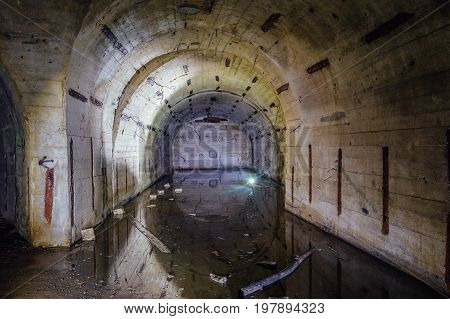 Flooded arced room at Object 221, abandoned soviet bunker, reserve command post of Black Sea Fleet