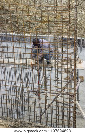 Worker Adding The Rebar For Support 2