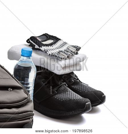 Sport equipment on white background. Water, towel, gloves, sneakers and backpack