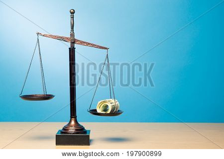Money justice scales background paper isolated closeup