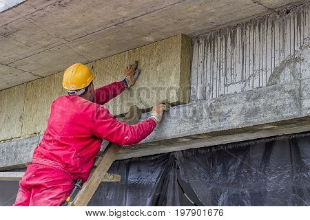 Man Installing External Wall Insulation 4