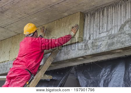 Man Installing External Wall Insulation 5