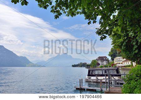 Vitznau Switzerland - June 14 2017: Beautiful view on the lake Luzern nearby city of Vitznau. Mountain Pilatus on background