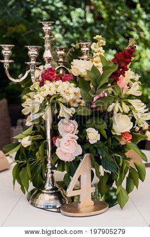 Wedding decor table setting and flowers with linens