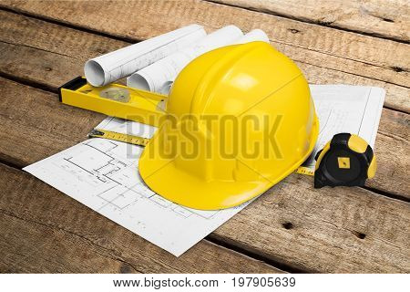 Yellow helmet blueprints handy work industrial engineering objects background