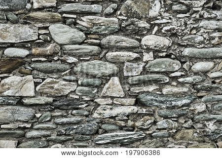 Fragment of the ruined stone wall in Greece