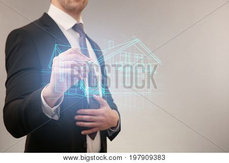 Real estate agent drawing house on virtual screen against light background