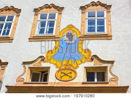 Salzburg, Austria - May 01, 2017: Sundial on the building wall at the square of St. Peter, Salzburg, Austria on May 01, 2017. Salzburg is renowned for its baroque architecture. It is an Unesco World Heritage Site.