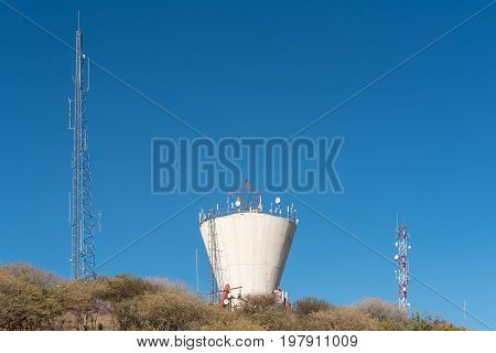 A water reservoir and telecommunications towers in the centre of Windhoek the capital city of Namibia