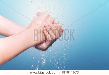 Man hands washing color blue background view
