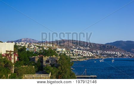 View of the Gumbet Bay. Mountainous terrain near the Aegean Sea. Typical buildings on the mountain near the sea. Bodrum. Turkey.