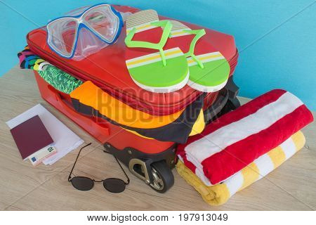 Suitcase with different things prepared for travel. Travel and vacations concept. Suitcase with things for spending summer vacation