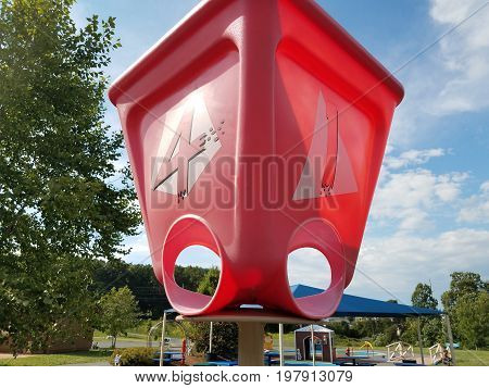 red plastic basket or bucket with the numbers 1 and 4