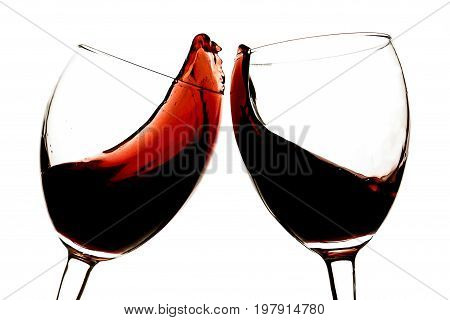 Red wine glasses clinking bar color white