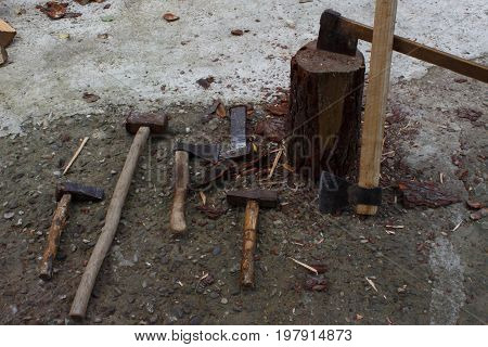 Tools for chopping trees. old rusty axe wedges and sledgehammer. Tools for chopping trees