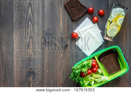 Heathy meal in office. Lunch box on dark wooden table background top view