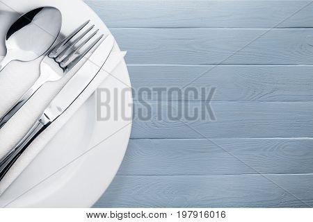 Knife spoon plate fork group white objects