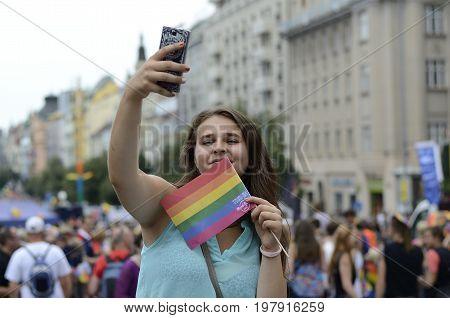 Prague, Czech Republic, August 15, 2016, Editorial photo girl with rainbow flag who is take a selfie, Prague, Czech Republic