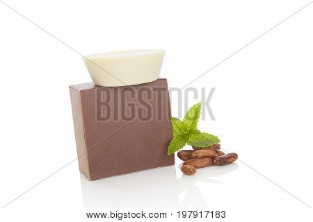 Healthy massage cocoa soap with cocoa seeds isolated on white background. Natural cosmetics. Healthy organic skin care.