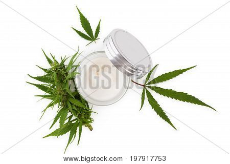 Cannabis hand cream in silver dose with marijuana plant isolated on white background from above. Cannabis cosmetics.